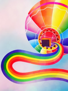 Hot air balloon and rainbow