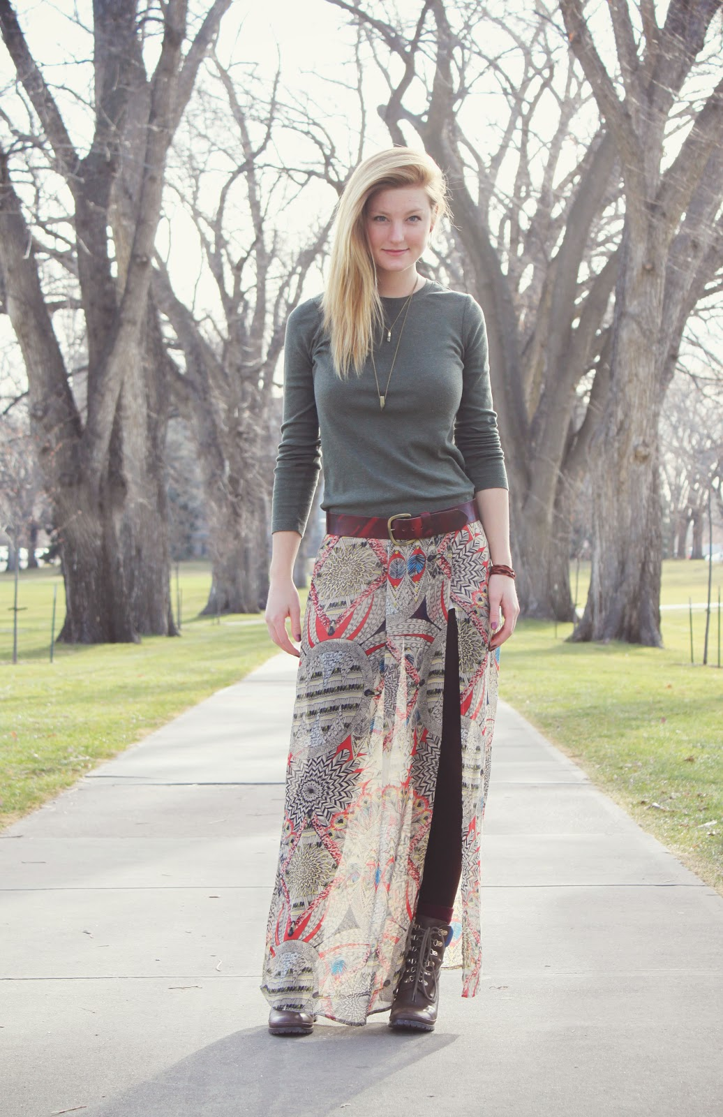Colorado State University Student Jules Davies, wears a print diaphanous drape over skinny black jeans, combat boots and a charcoal top. Featured are her own jewelry designs which can be found at Fox Nine on Etsy