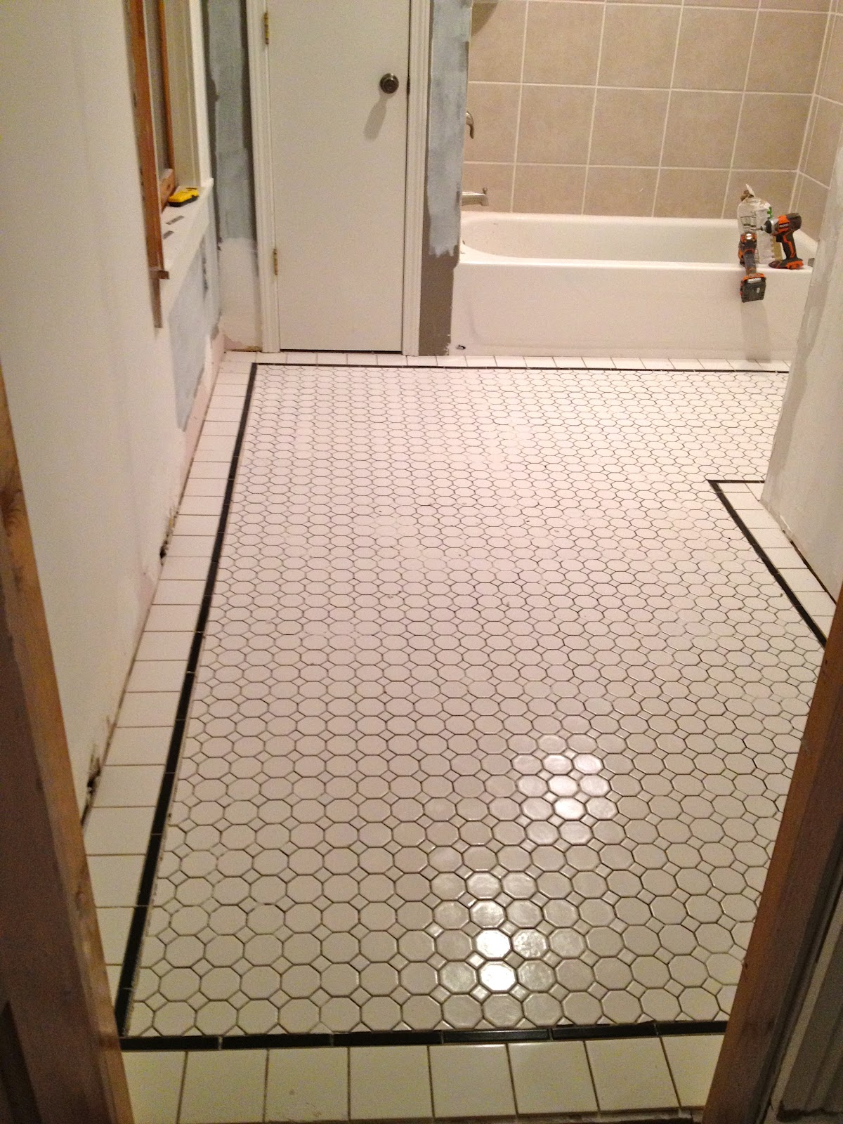 Mel & Liza: Bathroom Renovation: Finishing the Tile Floors