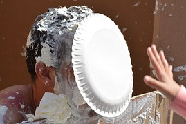 man with a cream pie in his face