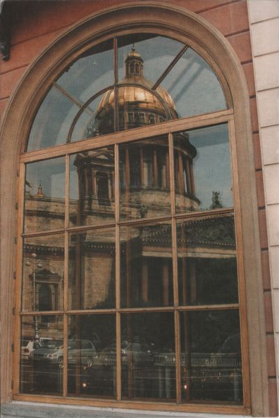 reflection in an arched window of the dome of St Isaac's cathedral