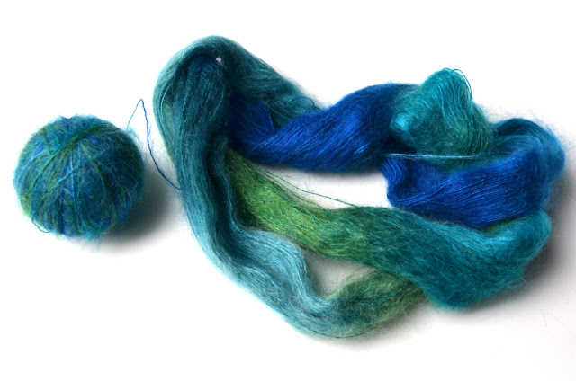 silk mohair, half in a ball, half an untwisted hank in blue-greens.