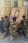 'They Accept Us as We Are;' Christians Join Forces With Muslim Group Hezbollah to Fight ISIS