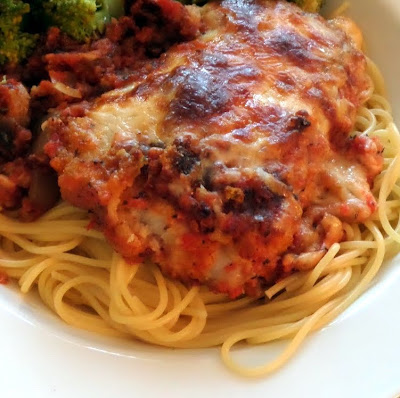 Chicken Parmesan:  Breaded chicken in a tomato sauce smothered in Parmesan and mozzarella cheeses.