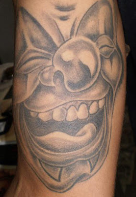 black and grey clown tattoo