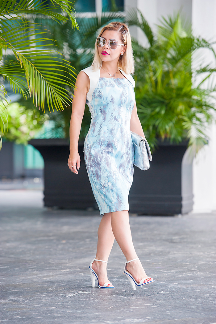 Crystal Phuong looking fresh and radiant in Elie Tahari blue and white dress and Raoul silver clutch