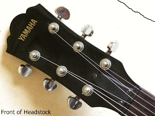 Yamaha AES620 Charcoal Gray (CG) - front of headstock