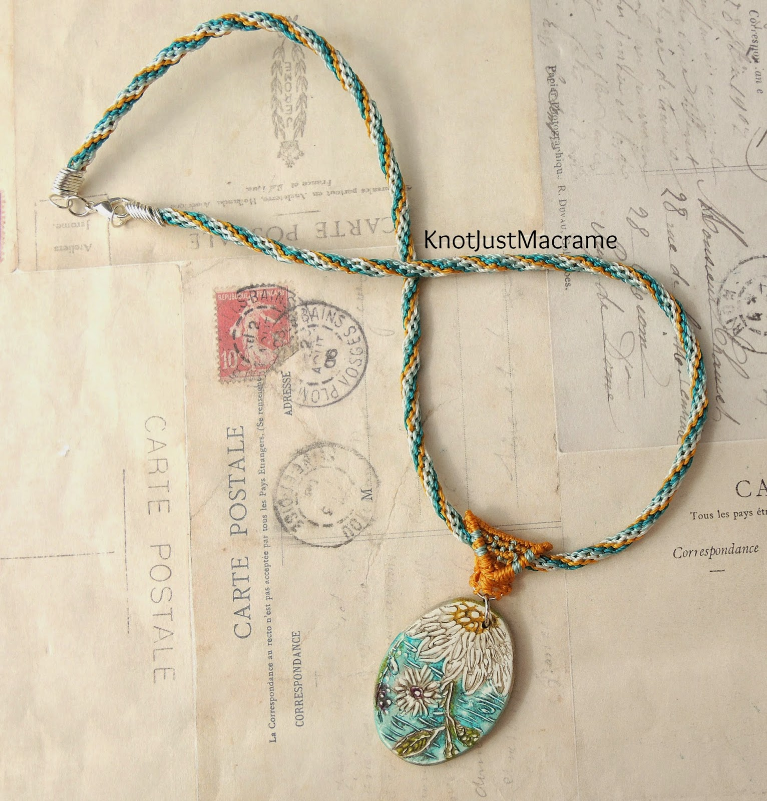 Knotted micro macrame necklace with daisy pendant in teal and mustard.