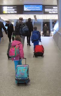 Children pulling their luggage