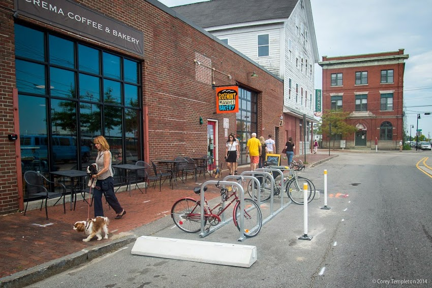 Bike parking corral in Portland, Maine USA on Commercial Street in front of Crema Coffee and Rosemont Market Bakery. September 2014. Photo by Corey Templeton.