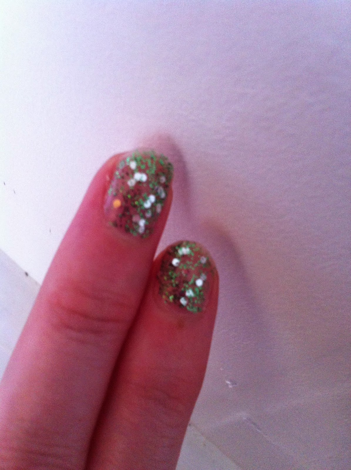 Green and Silver glitter nailpolish O.P.I