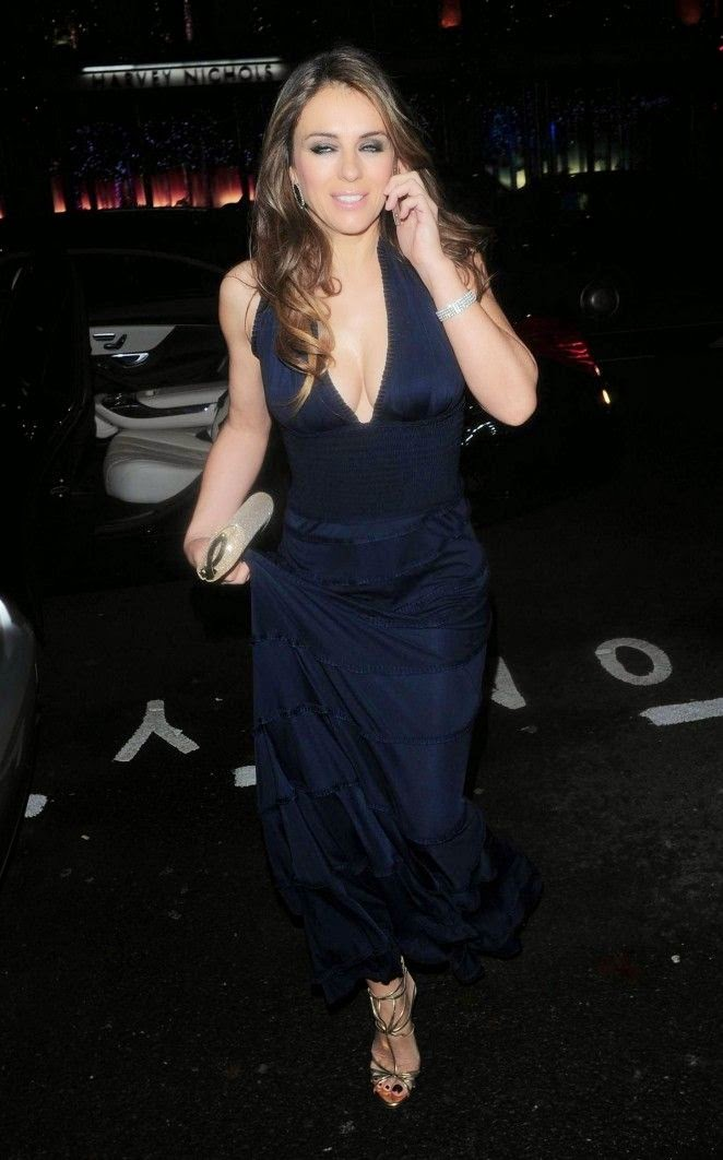 Making sure her outfit was perfectly, the 49-year-old slipped in a long gown during her night at Mandarin Oriental Restaurant at London, England on Saturday, November 27, 2014.
