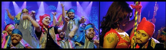 Veera dancing and leering as a man during the theatrical performance.