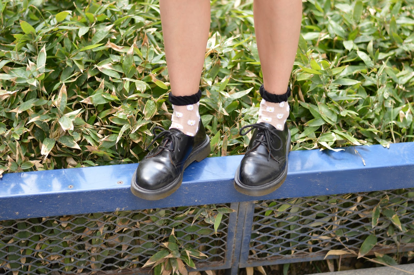 Nineties grunge Dr Martens black shoes and Primark daisy socks