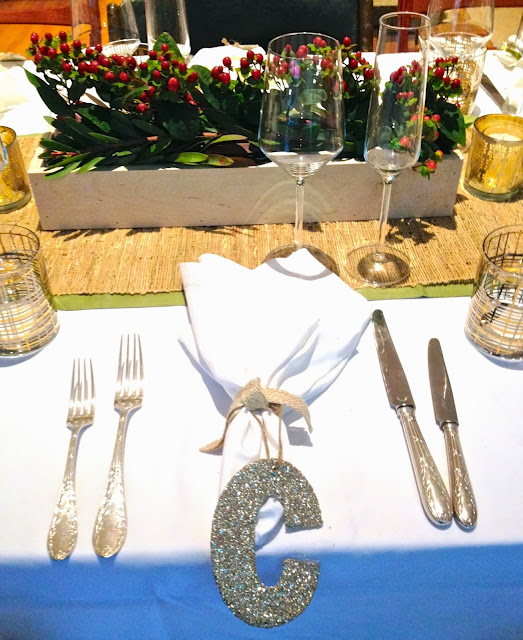 Holiday table setting with straw runner and Christofle flatware