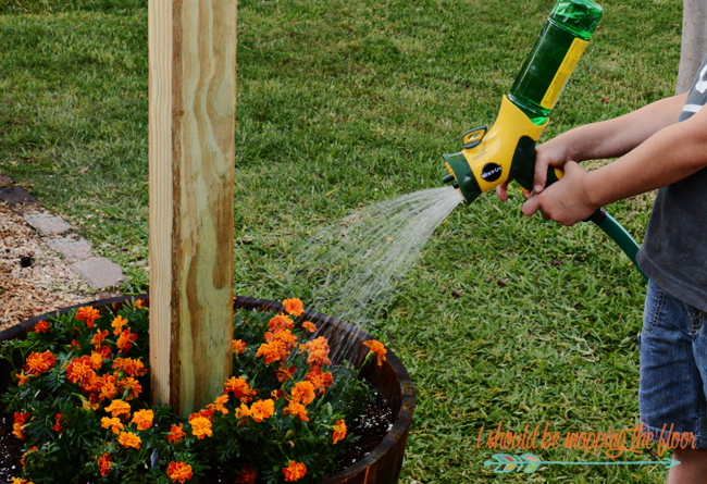 DIY Patio Area with Texas Lamp Posts | Add a patio with fun planter posts to a backyard area.