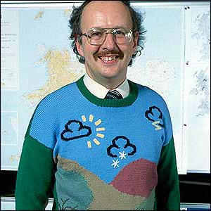 BBC Weatherman Michael Fish wearing one of many knitted jumpers sent in by viewers