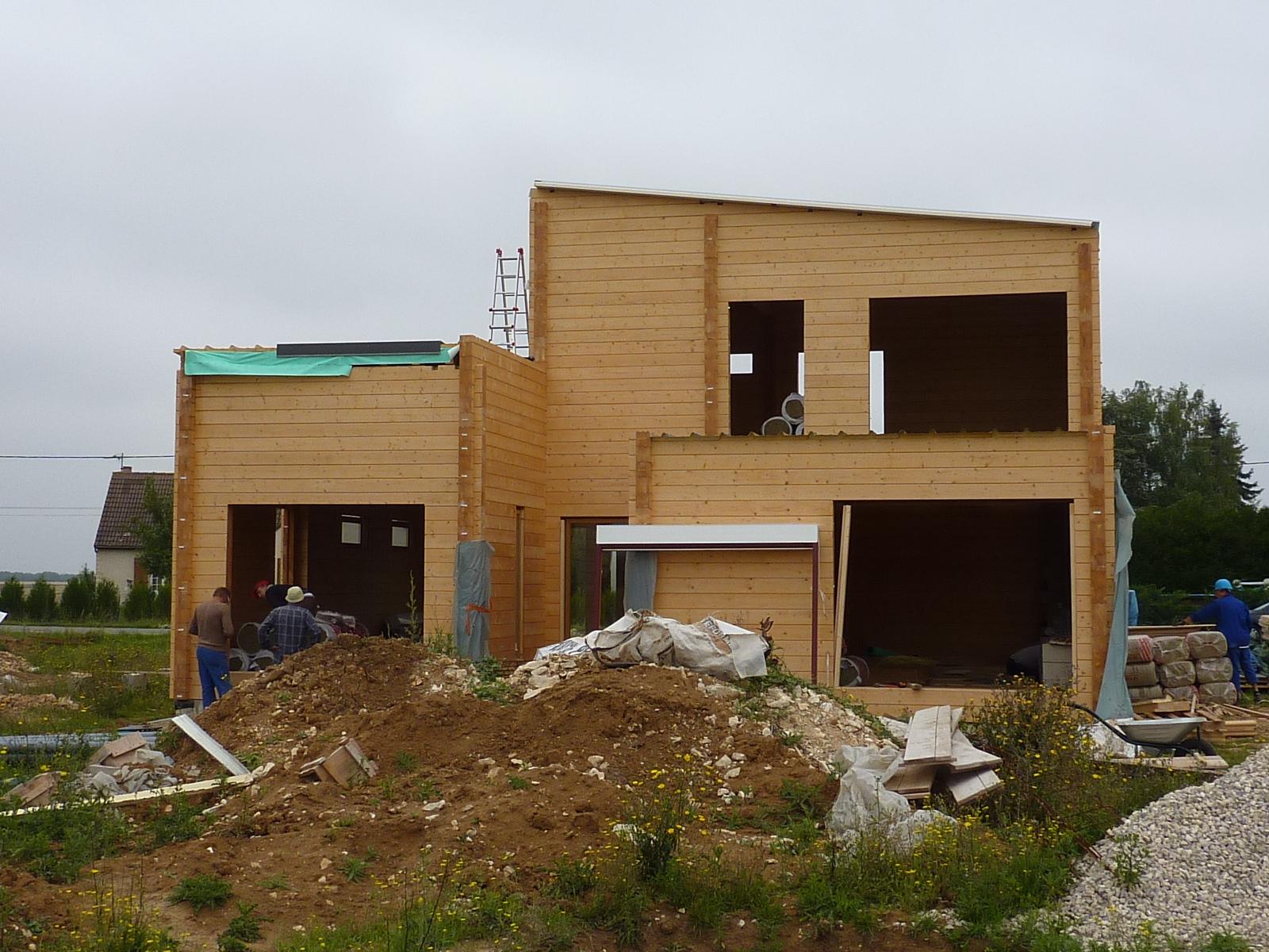 Maison bois en madrier construction modern architecture for Maison bois en u