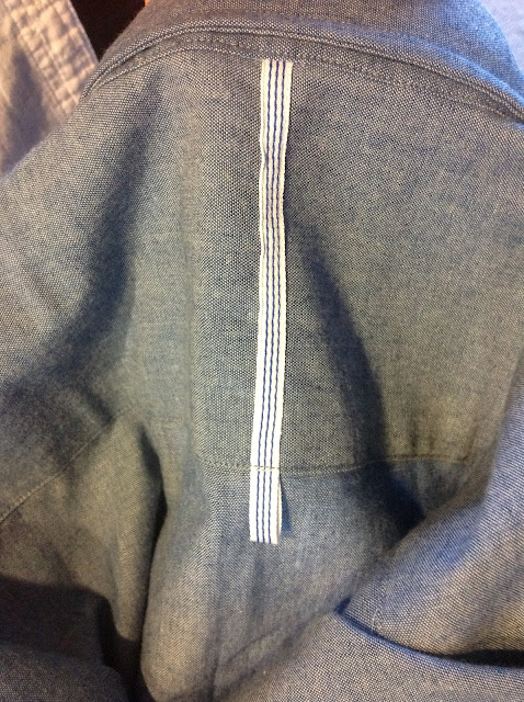 Signature hanging loop on a Crawford and Sons shirt