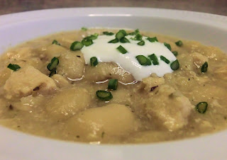 White chicken chili with cannellini beans sour cream and cumin