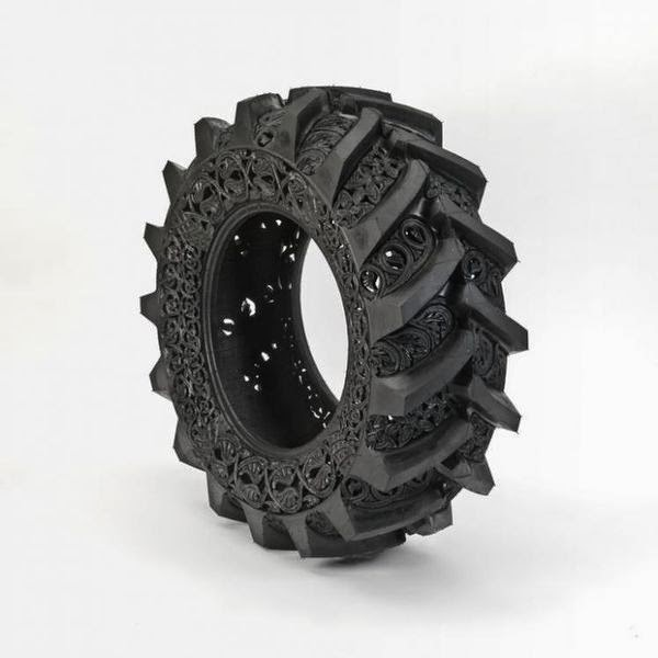 wim-delvoyes-incredible-rubber-carvings-turn-tires-into-art 6