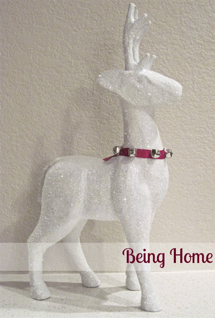 white painted and glitter covered mache reindeer with collar