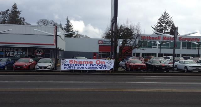 What would you write on a sign if you were picketing a car dealership?