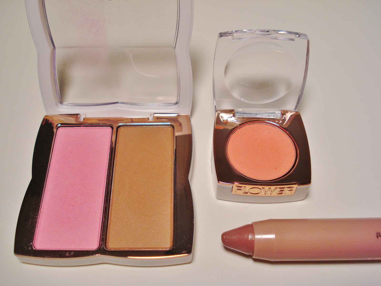 Flower beauty from drew barrymore first impressions makeupwednesday clockwise from left flower ready set glow blushbronzer duo in gloriously golden flower win some rouge some creme blush in peach blossom flower sheer izmirmasajfo