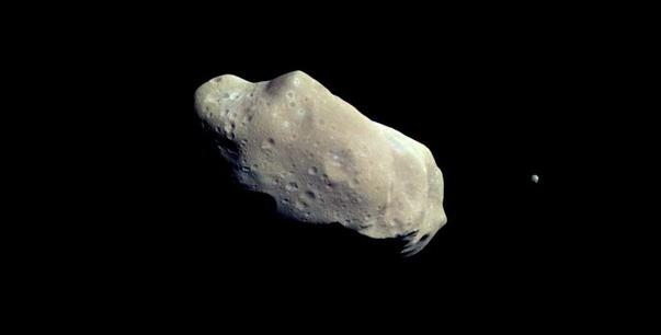 Asteroid Ida with its moon Dactyl. Credit: LANL