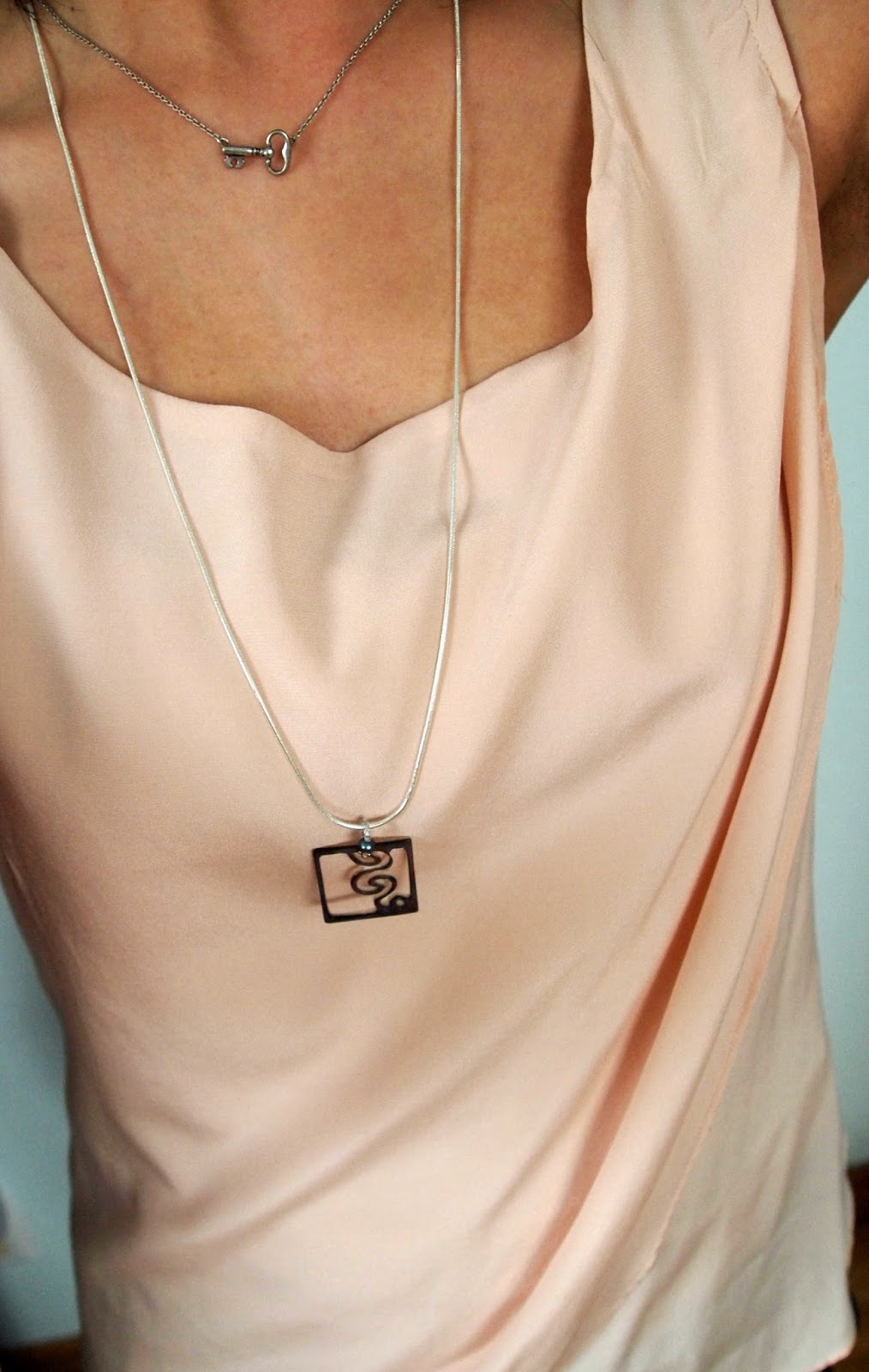 layered necklaces pink silk top drape teacher style
