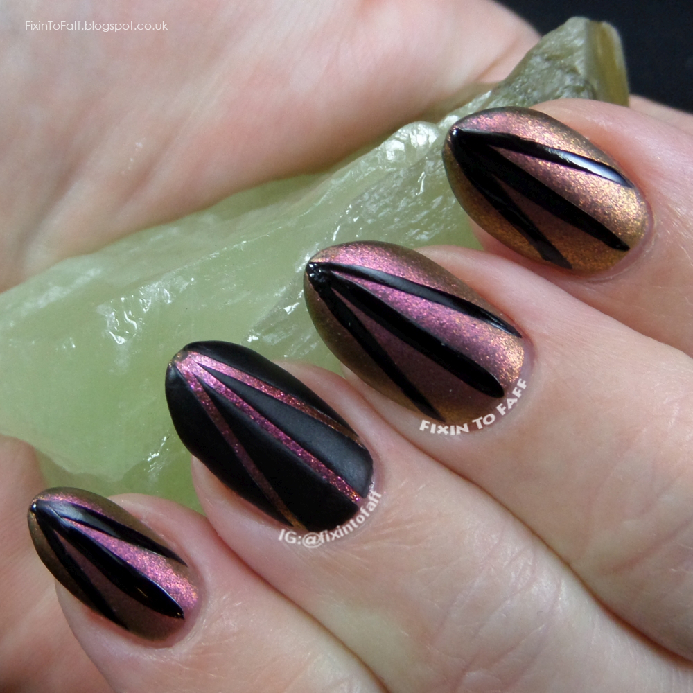 Striped matte and glossy nail art with firey duochrome shimmer base.