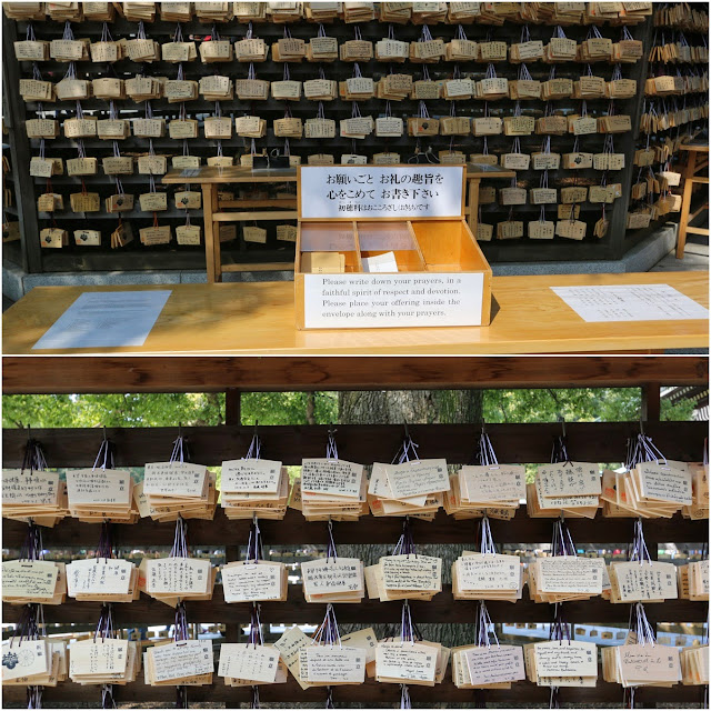A guided instruction to write and slip your prayers together with your offerings in the envelope at Meiji Shrine in Tokyo, Japan