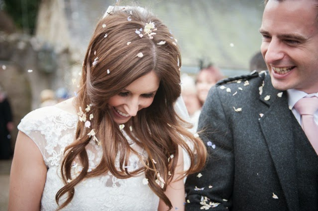 Bride and groom with confetti after the ceremony at Glen Tanar Estate in Scotland