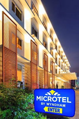 Mango Tours Microtel by Wyndham Acropolis Hotel Facade
