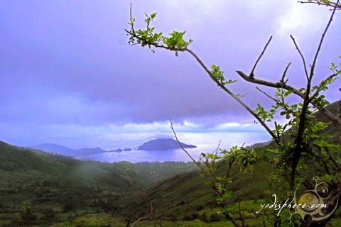 Picturesque view of Silanguin Cove against the foggy sky from the top of Mt. Cinco Picos hover_share