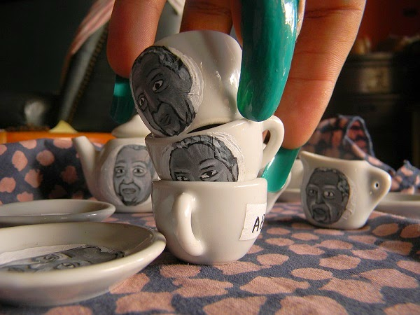 Three little teacups with Duvalier portraits