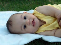 Baby in yellow. Stock Photo credit: mirichi