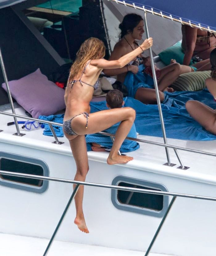 Gisele Bundchen was spotted raising the temperatures by a shower scene in a zebra bikini while indulging on vacation with family and friends on Friday, April 4, 2014 at Brazil.
