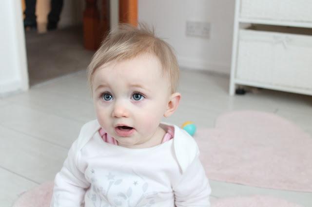 baby girl white wooden floor pink heart rugs