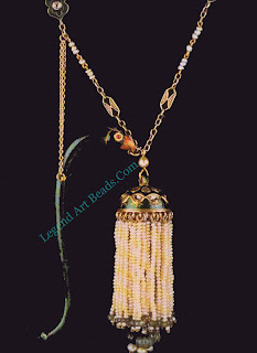 A tram is a jewelled tassel which hangs from a turban by means of a jewelled or enamel stem. In t his 19th-century example of enamel, seed pearls, and diamonds, the stern takes the form of a parrot's head.