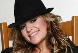 Jenni Rivera in black cap