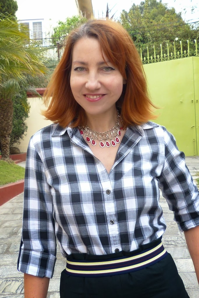 Checkered shirt, red stones necklace