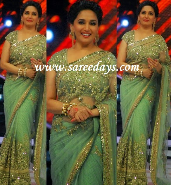 Latest saree designs madhuri dixit in sabyasachi mukherjee saree checkout madhuri dixit in sabyasachi mukherjee saree with gold work along the border and gold work all over the saree and paired with matching short sleeves altavistaventures Image collections