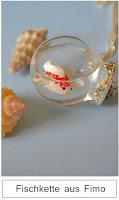 http://kristallzauber.blogspot.de/2014/06/diy-fisch-im-glas-kette.html
