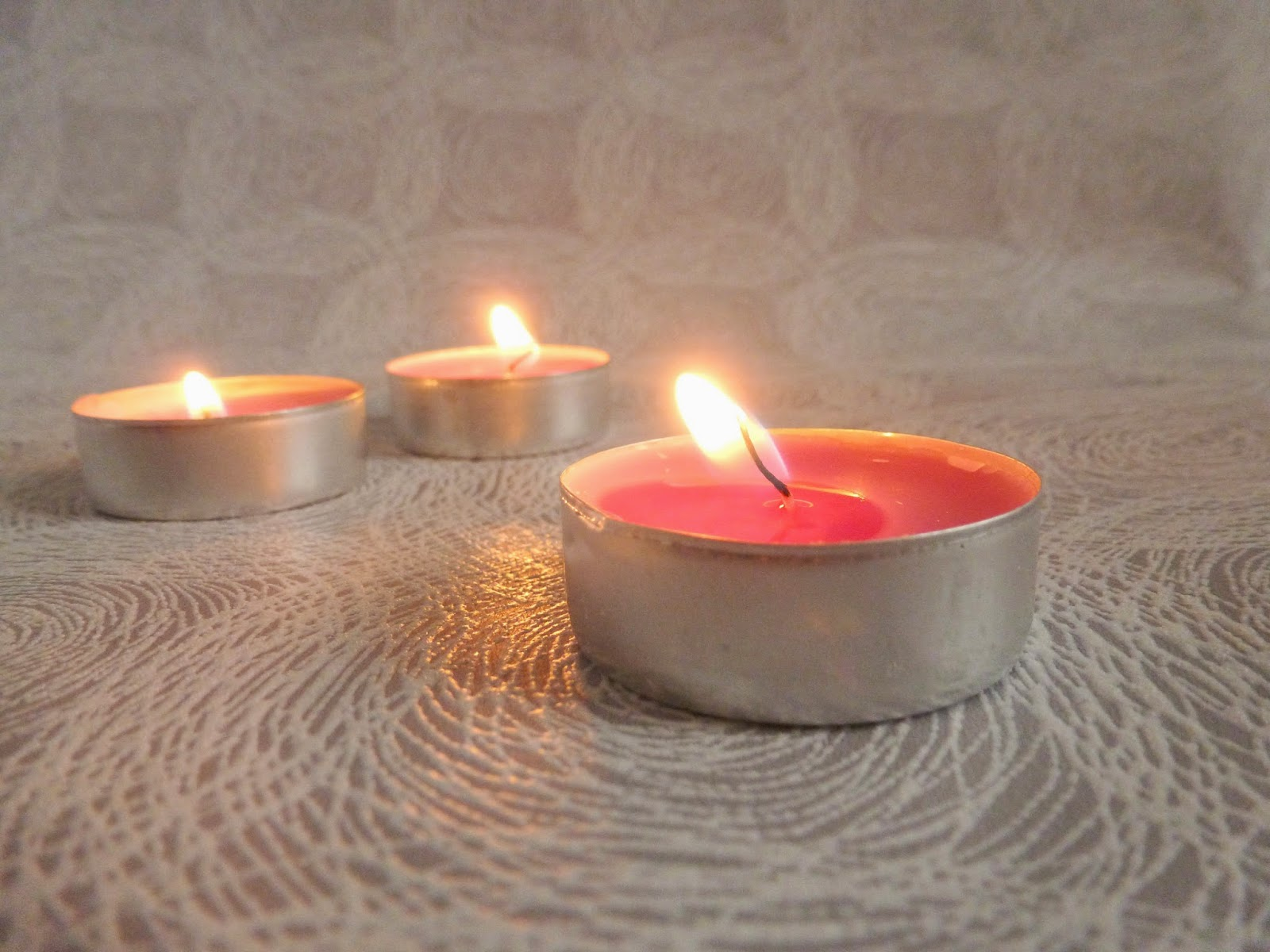 Lit tea light candles