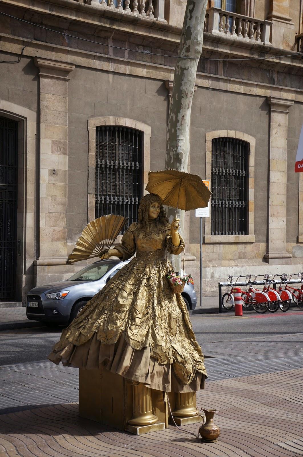 Human statue in gold, Las Ramblas district of Barcelona Spain.