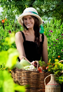 Caucasian Young Woman in a Hat Walking in the Garden