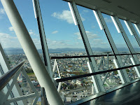 Slanted windows inside Goryokaku Tower, hakodate city ocean and mountains are visible in the background through the windows