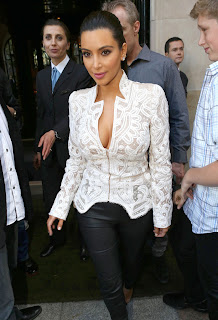 Kim Kardashian surrounded by fans as she leaves a Restaurant in Paris