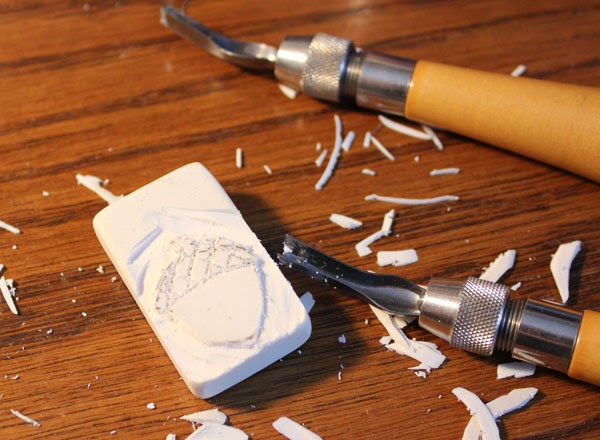 carving an acorn stamp from a white eraser
